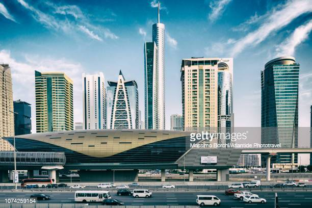 jumeirah lakes towers metro (subway) station and the jumeirah lakes towers - image stock pictures, royalty-free photos & images