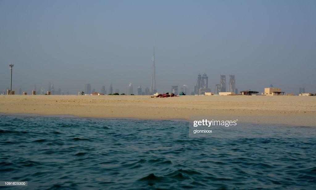 Jumeirah public beach and Dubai skyline, UAE : Stock Photo