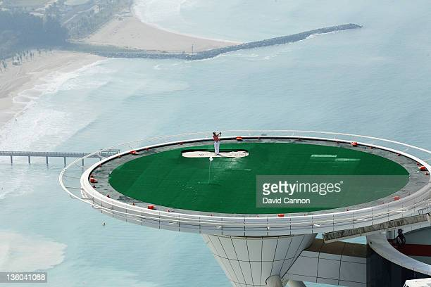 Jumeirah's Global Brand Ambassador Rory McIlroy of Northern Ireland completes a remarkable year with another amazing bunker shot on the helipad at...