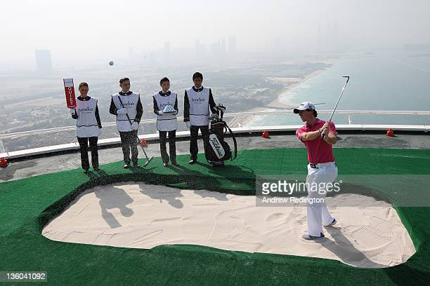 Jumeirah's Global Brand Ambassador Rory McIlroy of Northern Ireland completes a remarkable year with another amazing bunker shot watched by Burj Al...