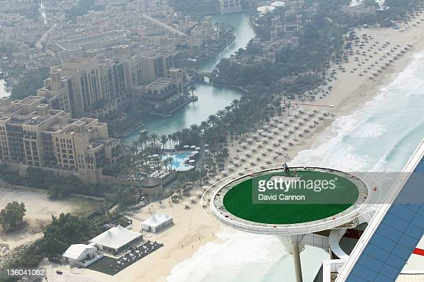 Jumeirah's Global Brand Ambassador Rory McIlroy of Northern Ireland hits his spectacular final shots of 2011 on the helipad at the Burj Al Arab hotel...