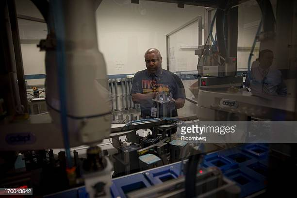 Jumel Alston works on the production line for one ounce silver bullion coins at the United States Mint at West Point in West Point New York US on...