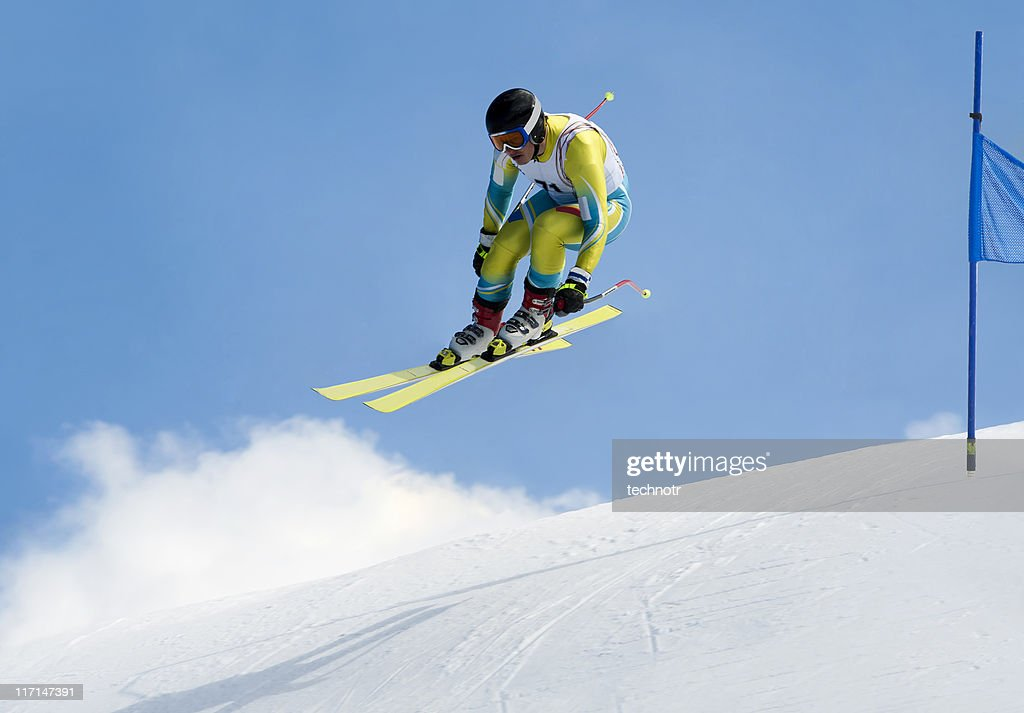 Jump during the downhill race : Stock Photo