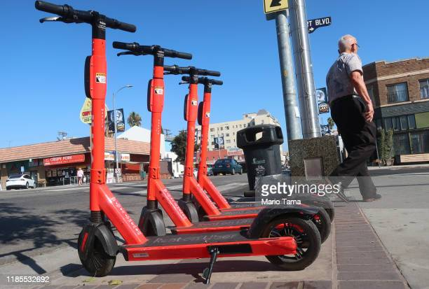 Jump escooters an Uber subsidiary are parked on a sidewalk on November 4 2019 in Los Angeles California Uber's permit to rent out Jump escooters and...