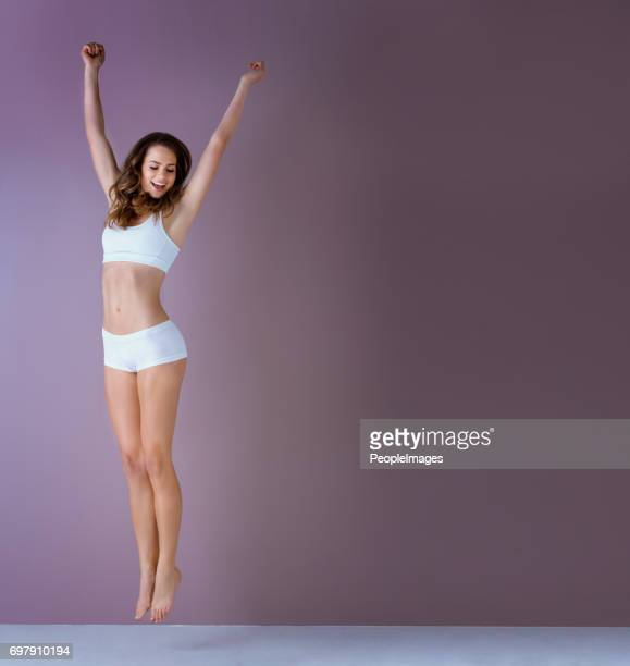 jump if you feeling healthy and happy - slim stock pictures, royalty-free photos & images