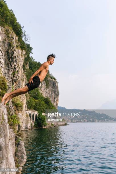Jump in the water, Young man diving