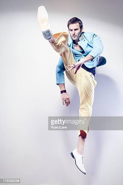 jump kicking man - kicking stock pictures, royalty-free photos & images