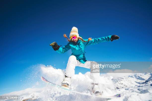 jump - snowboarding stock pictures, royalty-free photos & images