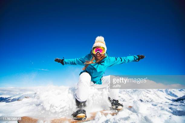 jump - blue hat stock pictures, royalty-free photos & images
