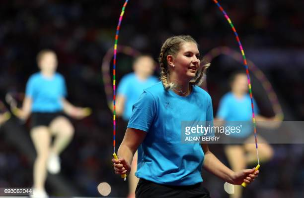A jump rope performer shows her act at the Stadium Gala of the 2017 Deutsches Turnfest at the Olympic Stadium in Berlin on June 6 2017 / AFP PHOTO /...