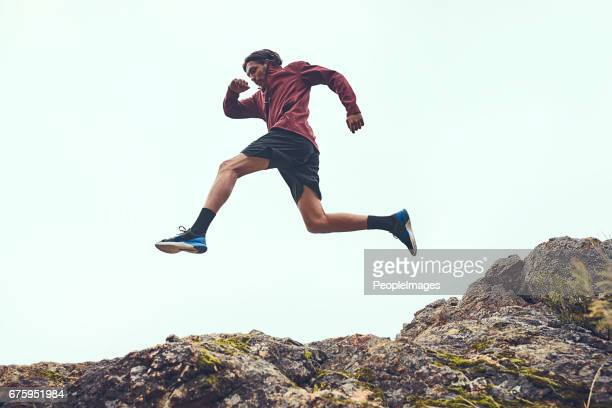 jump straight over any obstacles in your way - remote location stock pictures, royalty-free photos & images