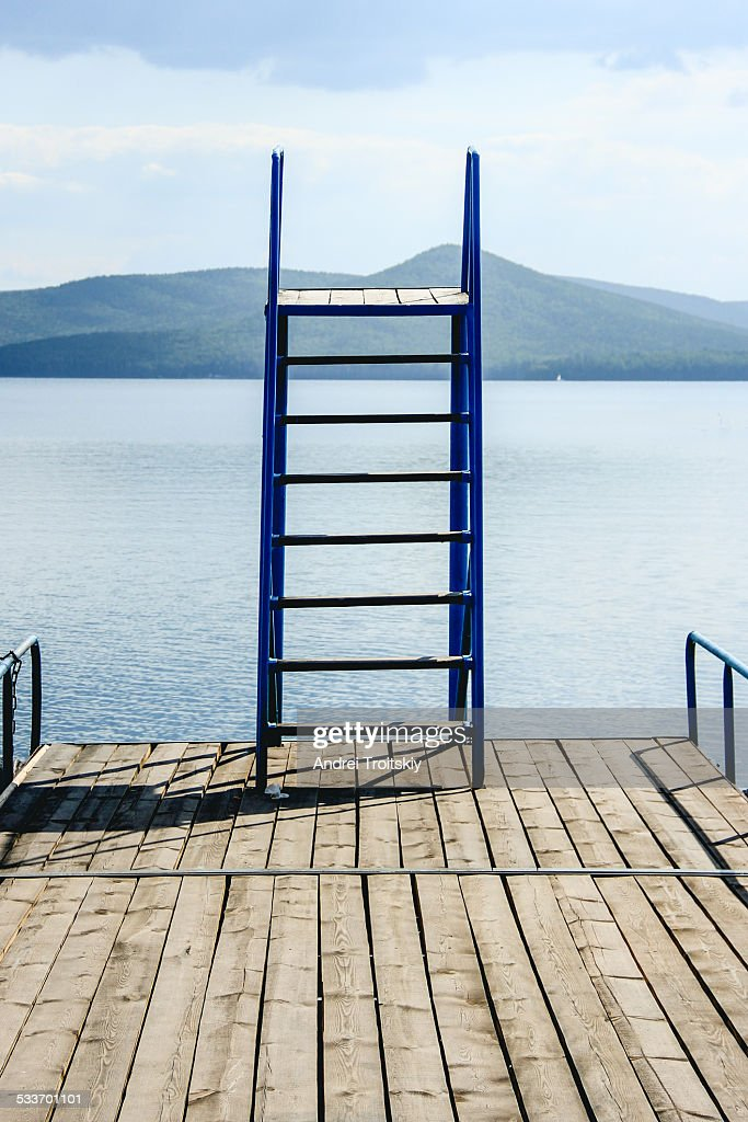 Jump tower on the bridge boat on lake in summer : Foto stock