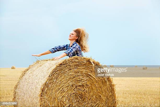 Jump up at bale of straw with hands ahead