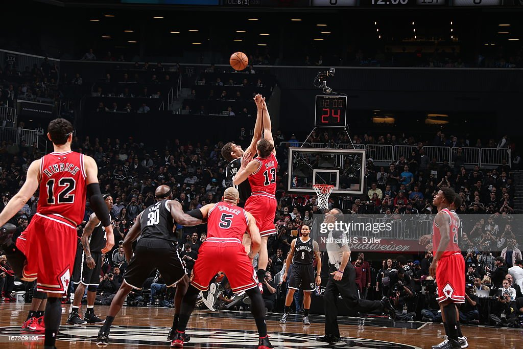 Jumpball between Brook Lopez #11 of the Brooklyn Nets and Joakim Noah #13 of the Chicago Bulls in Game One of the Eastern Conference Quarterfinals during the 2013 NBA Playoffs on April 20 at the Barclays Center in the Brooklyn borough of New York City.