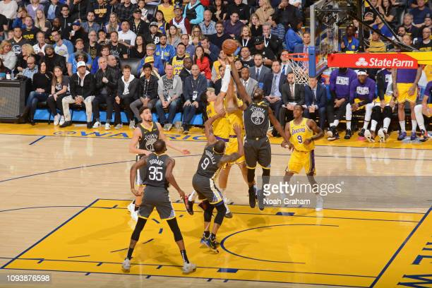 A jumpball between Kyle Kuzma of the Los Angeles Lakers and Draymond Green of the Golden State Warriors on February 2 2019 at ORACLE Arena in Oakland...