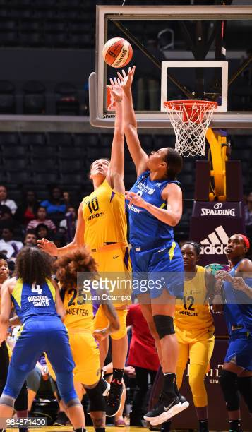 A jumpball between Maria Vadeeva of the Los Angeles Sparks and Elizabeth Cambage of the Dallas Wings on June 26 2018 at STAPLES Center in Los Angeles...