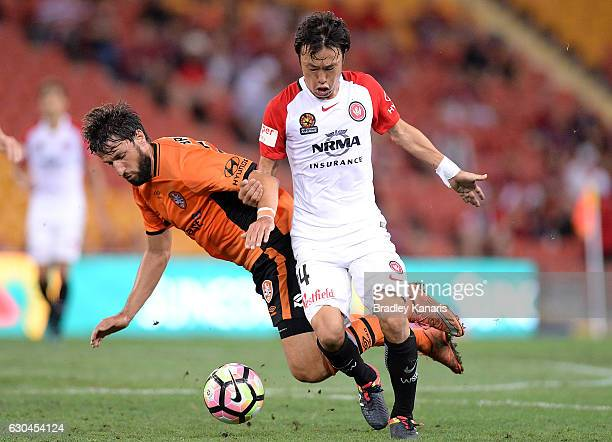 Jumpei Kusukami of the Wanderer is challenged by Thomas Broich of the Roar during the round 22 ALeague match between Brisbane Roar and Western Sydney...