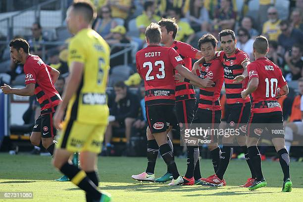 Jumpei Kusukami of the Wanderers celebrates with team mates after scoring a goal during the round nine A-League match between Central Coast Mariners...