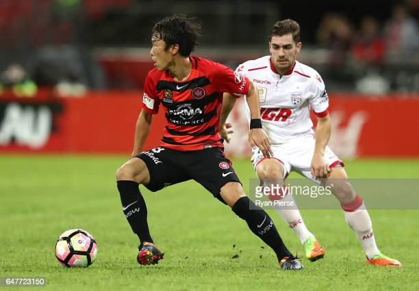Jumpei Kusukami of the Wanderers competes for the ball against Ben Garuccio of Adelaide United during the round 22 ALeague match between the Western...