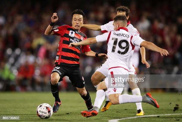 Jumpei Kusukami of the Wanderers competes for the ball against Ben Garuccio of United during the FFA Cup Semi Final match between the Western Sydney...