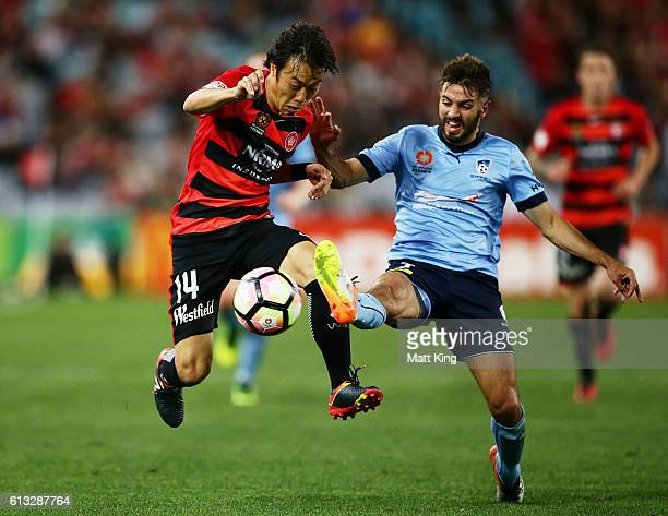 Jumpei of the Wanderers is challenged by Michael Zullo of Sydney FC during the round one ALeague match between the Western Sydney Wanderers and...