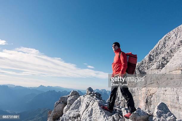 BASE jumper checking the exit spot and the wind, Italian Alps, Civetta, Alleghe, Belluno, Italy