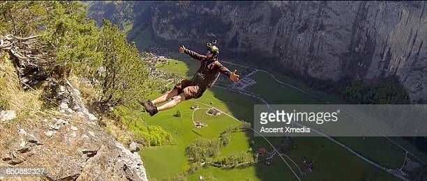 BASE jumper faces backwards after cliff launch