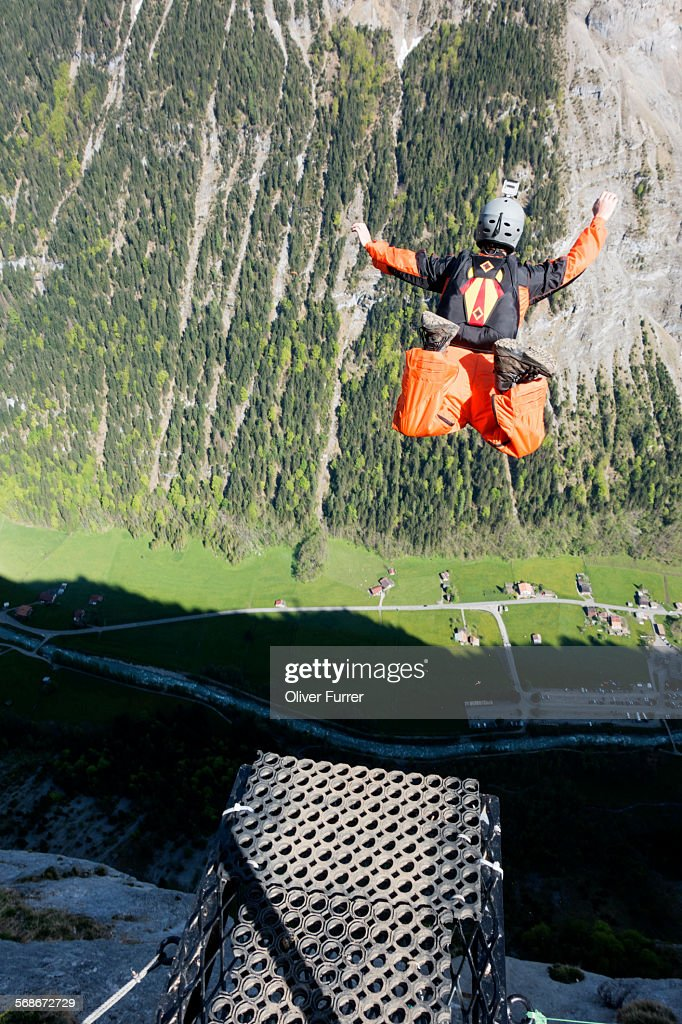 BASE jumper got of a ramp and is falling down : Stock Photo