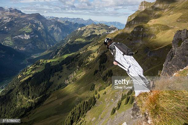 BASE jumper is exiting from a mountain