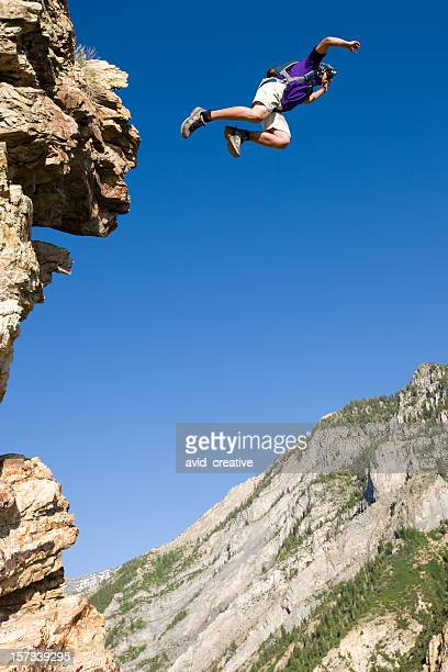 BASE Jumper Leaping Off Cliff
