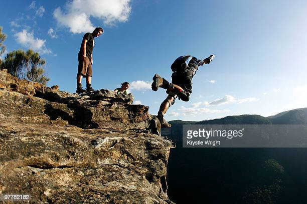 A BASE jumper performs a front flip off a cliff in the Blue Mountains, New South Wales, Australia.