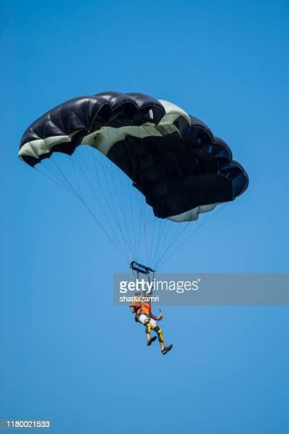 a base jumpers in jumps off from kl tower at kuala lumpur, malaysia - shaifulzamri imagens e fotografias de stock