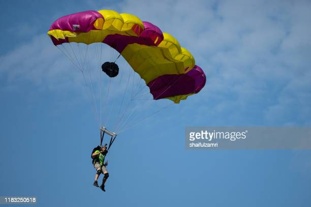 a base jumpers in jumps off from kl tower in kuala lumpur, malaysia. - shaifulzamri stock pictures, royalty-free photos & images