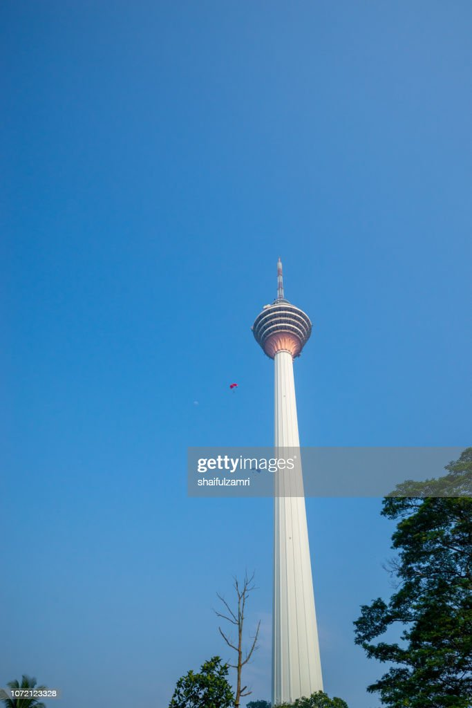 A BASE jumpers in jumps off from KL Tower. KL Tower BASE Jump is an annually event and participants from experienced BASE jumpers from all around the world. : Stock Photo
