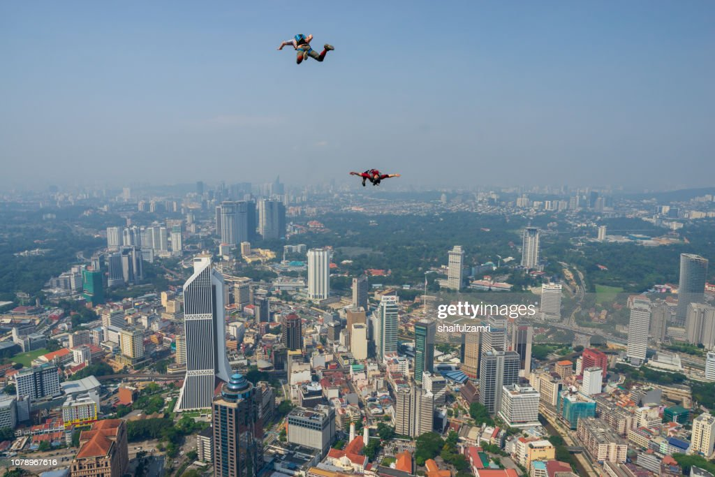 2 BASE jumpers jumps off from KL Tower at Kuala Lumpur. : Stock Photo