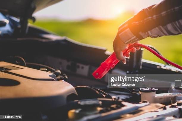 jumping battery car. - low stock pictures, royalty-free photos & images