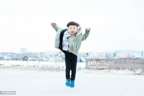 jumping boy - yusuke nishizawa stock pictures, royalty-free photos & images