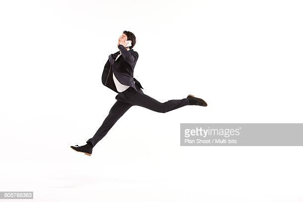 jumping business man with mobile phone jumping