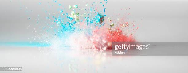 jumping color flour flying in the sky captured with high speed - gemahlen stock-fotos und bilder