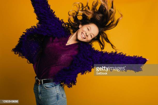 jumping for joy - lilac fashin stock pictures, royalty-free photos & images