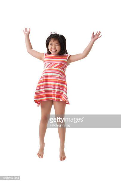 jumping for joy - fat little girls stock photos and pictures