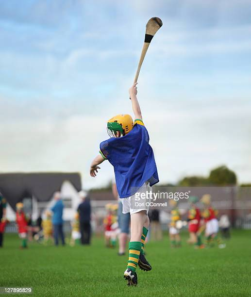 jumping for the sliother - hurling stock photos and pictures
