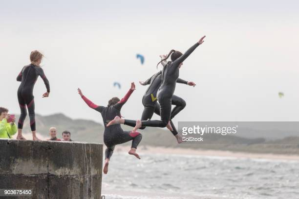 jumping from the harbour - water sport stock pictures, royalty-free photos & images