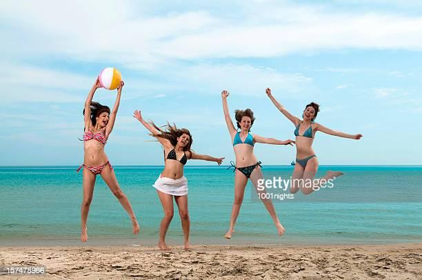 Jumping girls on the beach