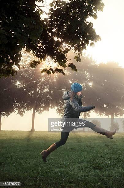 jumping happy women in autumn