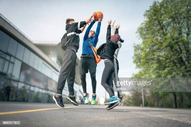 jumping high for the ball - basketball sport stock photos and pictures