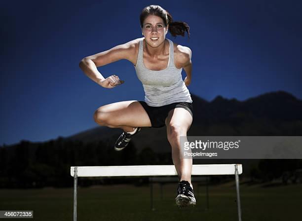 jumping hurdles - hurdle stock photos and pictures