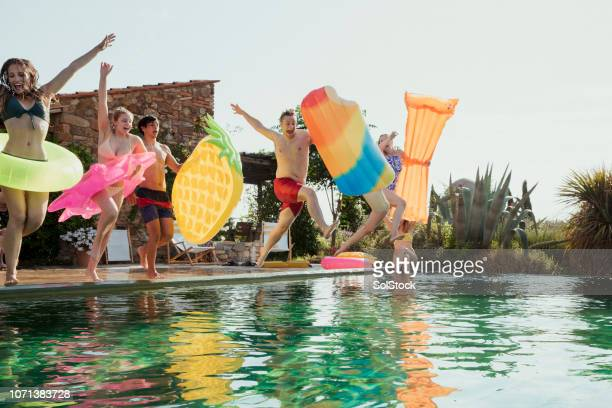 jumping in at a pool party! - pool party stock pictures, royalty-free photos & images