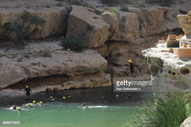 Jumping in natural pool from cliffs