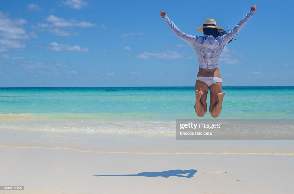 Jumping in the beach, Cayo Coco, Cuba. : Stock Photo